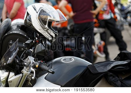 Moto Helmet On Motorcycle Handlebars
