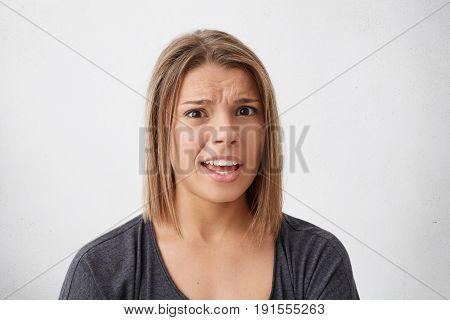 Gloomy Amazed Woman With Dyed Hair Looking With Popped Out Eyes And Opened Mouth Frowning Eyebrows B