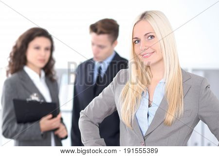 Face of beautiful cheerful smiling woman on the background of business people.
