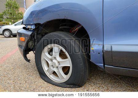 Car accident flat tire broken bumper. Old car.