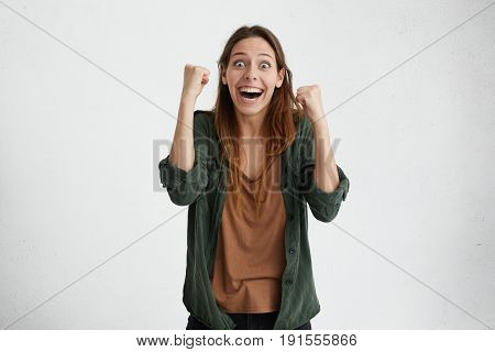 Stun Beautiful Woman In Casual Clothes Celebrating Her Victory Raising Hands Clenching Fists Having