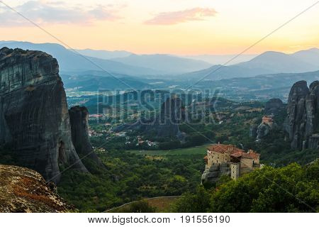 Greece. Meteora is incredible sandstone rock formations. The Holly Monastery of Rousanou in background