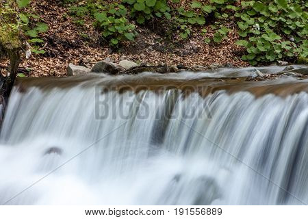Spring water rapid waterfall in the mountains
