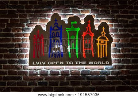 Backlit City Logo Of Lviv On Brick Wall