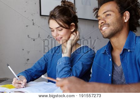 Friendly Pretty Woman In Blue Shirt Helping Her Mixed Race Friend With Curly Hair Explaining Him Mai