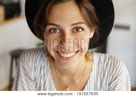 Close-up Portrait Of Beautiful Woman With Dark Eyes, Healthy Skin And Pleasant Smile Wearing Elegant