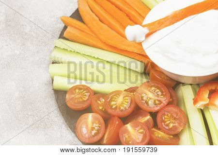 Creamy Sauce In White Bowl And Various Vegetables (tomatoes, A Celery, Cucumbers, Carrots). Copy Spa