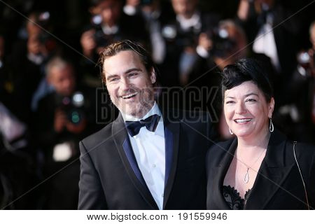Joaquin Phoenix and director Lynne Ramsay attend the 'You Were Never Really Here' screening during the 70th Film Festival at Palais des Festivals on May 27, 2017 in Cannes, France.