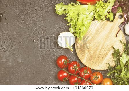 Assortment Of Fresh Vegetables (pepper, Cherry Tomatoes, Onions, Garlic, Lettuce) On A Dark Backgrou