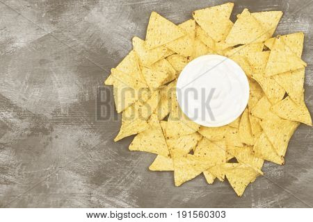 Creamy Sauce In White Bowl And Nachos. Top View, Copy Space. Food Background. Toning
