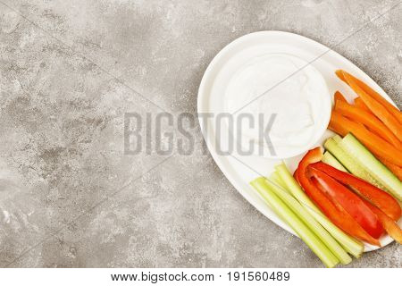 Creamy Sauce In White Bowl And Various Vegetables (tomatoes, A Celery, Cucumbers, Carrots). Top View
