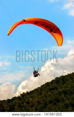 Turkey Oludeniz - June 23 2015: The flight of paragliders in the highlands. Paragliding.
