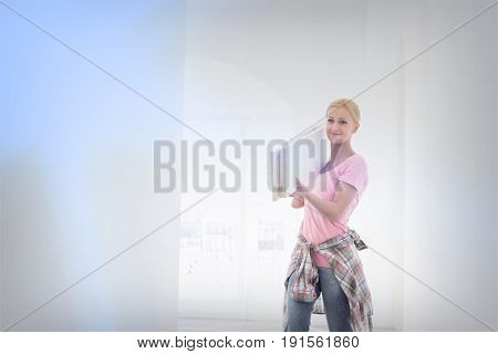 Woman carrying wooden planks on shoulder