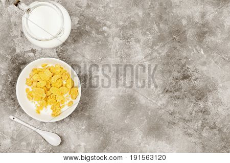 Cup Of Cornflakes With Milk On A Light Background. Top View, Copy Space. Food Background. Toning