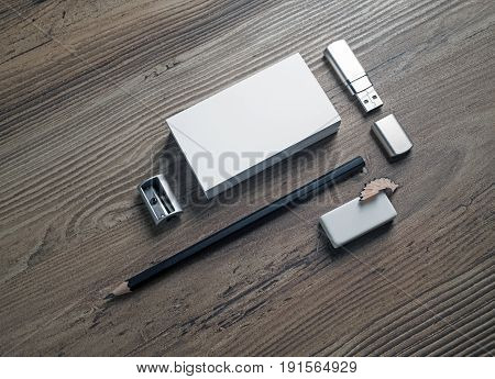 Business cards pencil eraser flash drive and sharpener on wooden table background. ID template. Photo of blank stationery. Mock up for design portfolios.