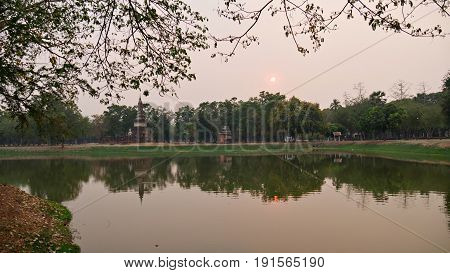 Sukothai Historical Park, Thailand The sunset reflected in a pond at the Sukhothai Historical Park, a UNESCO Heritage Site in Thailand.