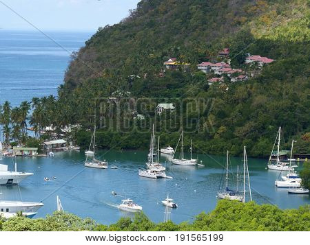 Scenic cove from an overlook at Santa Lucia, Caribbean Boats and yachts dot a small beautiful cove seen from an overlook at Santa Lucia, the biggest of Caribbean Islands windward.