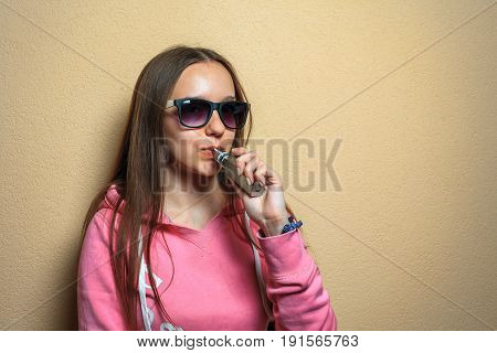 Vape Woman. Portrait Of Young Cute Girl In Pink Hoodie And Sunglasses Smoking An Electronic Cigarett