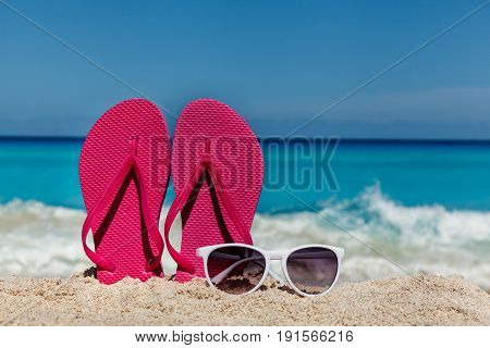 Flip flops on the sandy ocean beach in Cancun Mexico tropical vacation concept