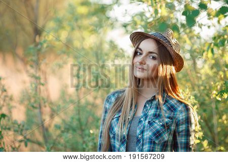 Attractive Young Blonde Woman In Blue Plaid Shirt Straw Hat Enjoying Her Time Outside Hiding From Su