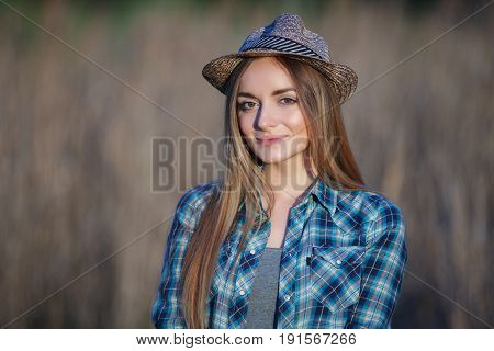 Attractive Young Blonde Woman In Blue Plaid Shirt Straw Hat Enjoying Her Time On Meadow Hard Noon Su