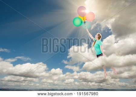Young Adult Female Being Carried Up and Away Into The Clouds By Balloons That She Is Holding.