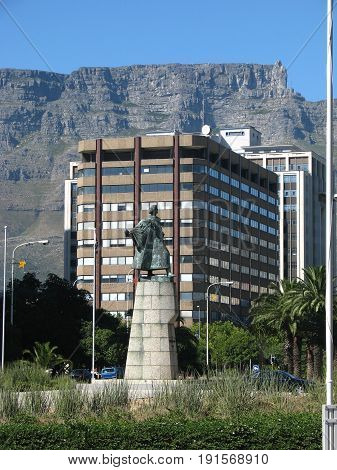 FROM CAPE TOWN, SOUTH AFRICA, A STATUE IN THE FORE GROUND, WITH TABLE MOUNTAIN IN THE BACK GROUND 28jh