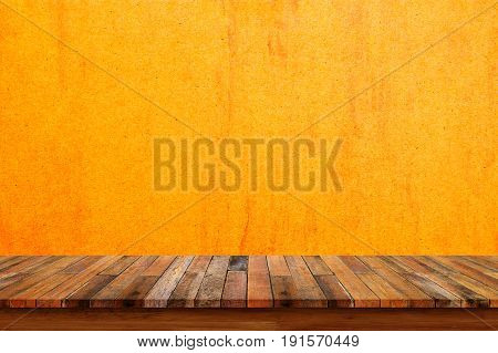 Empty wooden tabletop and yellow grunge wall background.