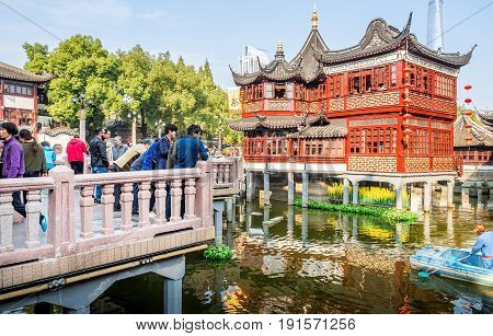 Shanghai, China - Nov 4, 2016: Around Yu Yuan (Yu Garden) - Old building with architectural structures in traditional Chinese styling converted to modern-day teahouse. Busy scene.
