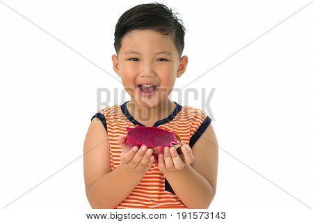 Little boy holding the dragon fruit isolated on white background