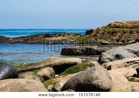Boulders and sandstone cliffs at La Jolla Cove, in San Diego County.