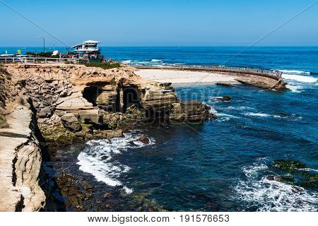 LA JOLLA, CALIFORNIA - JUNE 16, 2017:  The La Jolla Children's Pool with adjacent cliffside erosion and the newly constructed lifeguard tower.