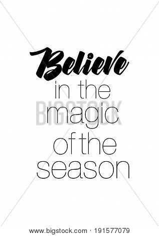 Isolated calligraphy on white background. Quote about winter and Christmas. Believe in the magic of the season.
