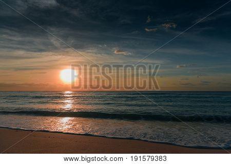 Sunset on the Caribbean Sea. Morning red sun.