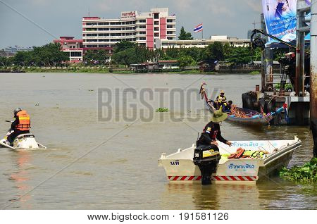 Security guard riding jet ski and rubber boat for safety and protection in long boat racing festival at Chaopraya river on November 8, 2015 in Nonthaburi, Thailand