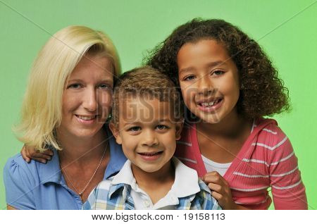 Mother and children's portrait isolated on a green background