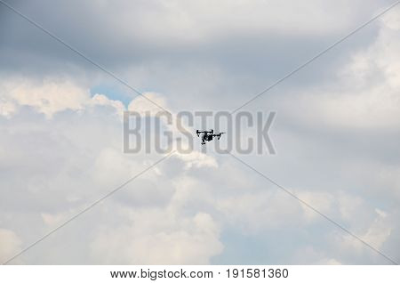 Surveillance drone flying in cloudy sky at Nonthaburi Thailand