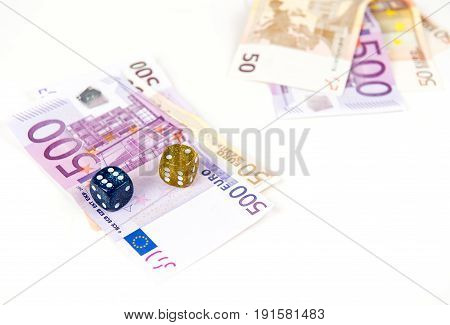 500 and 50 Euro bank notes and dices. Concept of gambling came