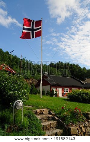 The Norwegian flag is waving against a blue sky, as I approached my first overnight stop in Norway. As small but nice hostel in Froland.