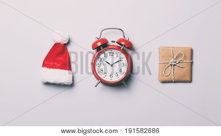 Red Alarm Clock And Christmas Gift With Hat