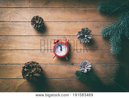 Alarm Clock And Pine Cones With Branches