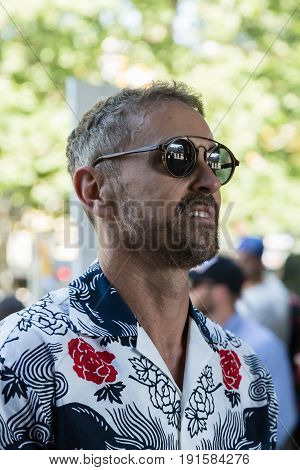MILAN ITALY - JUNE 17: Fashionable man poses outside Neil Barrett fashion show during Milan Men's Fashion Week on JUNE 17 2017 in Milan.