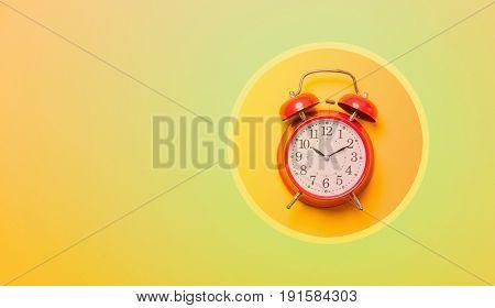 Red Alarm Clock In Cirlce