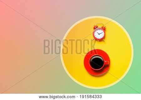 Red Cup Of Coffee And Alarm Clock