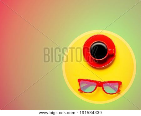 Red Cup Of Coffee And Sunglasses In Round