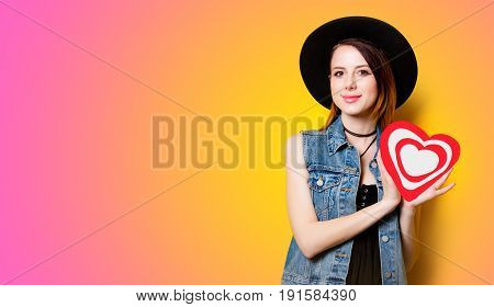 Young Woman Holding Drawing Heart Shape In Hands