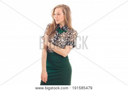 smiling slender girl in a bright dress posing in Studio isolated on white background