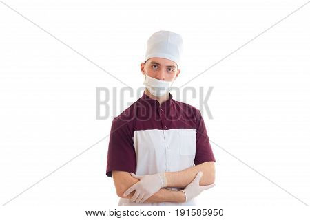 Portrait of a young Laboratory Assistant in the medical CAP and with a mask on his face isolated on white background