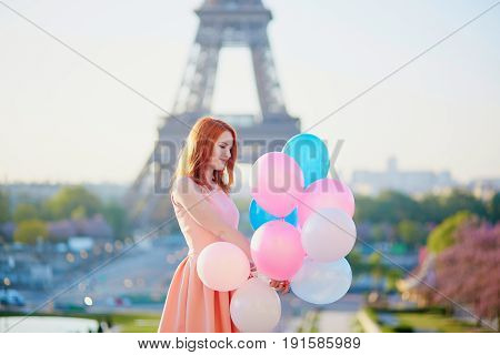 Girl With Bunch Of Balloons In Front Of The Eiffel Tower In Paris