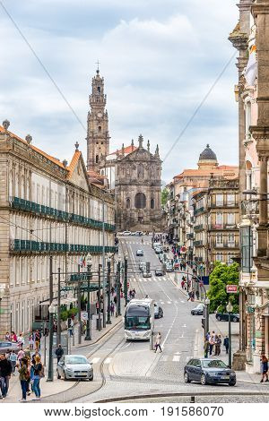 PORTO,PORTUGAL - MAY 13,2017 - In the streets of Porto - in the background Clerigos church. Porto is located along the Douro river estuary in Northern Portugal.